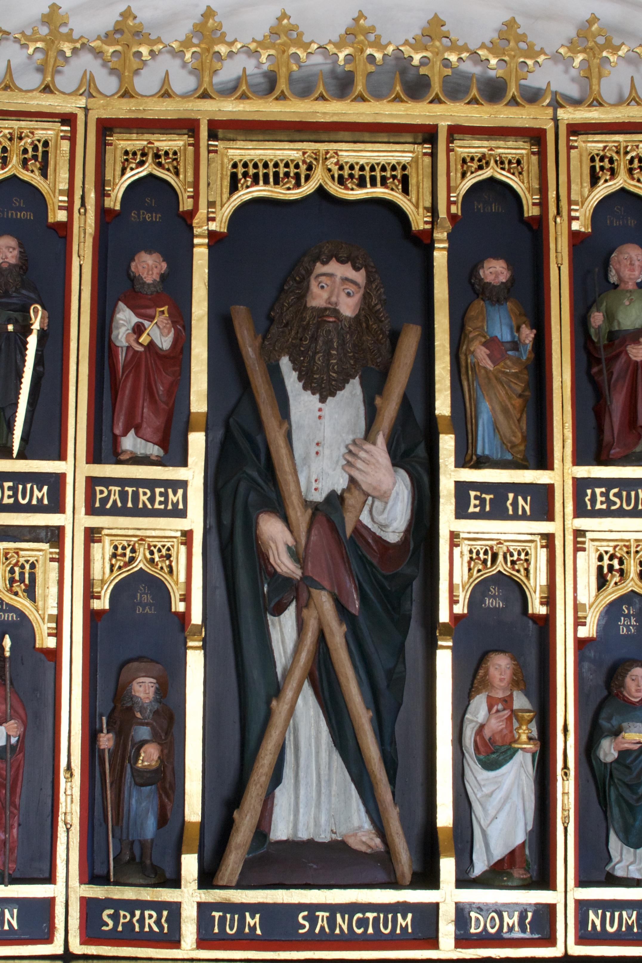 Apostelen Andreas med proptrækkerkrøllet hår og skæg og de to grene, der blev hans kors.